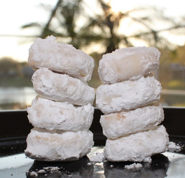 this is a recipe for a knockoff of a retired girl scout cookie called lemon coolers. The cookie is lemon flavored and rolled into powdered sugar these are stacked to show how they should look in this photo