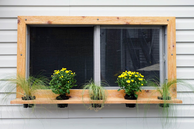 cedar floating shelf planter framing decorative window box