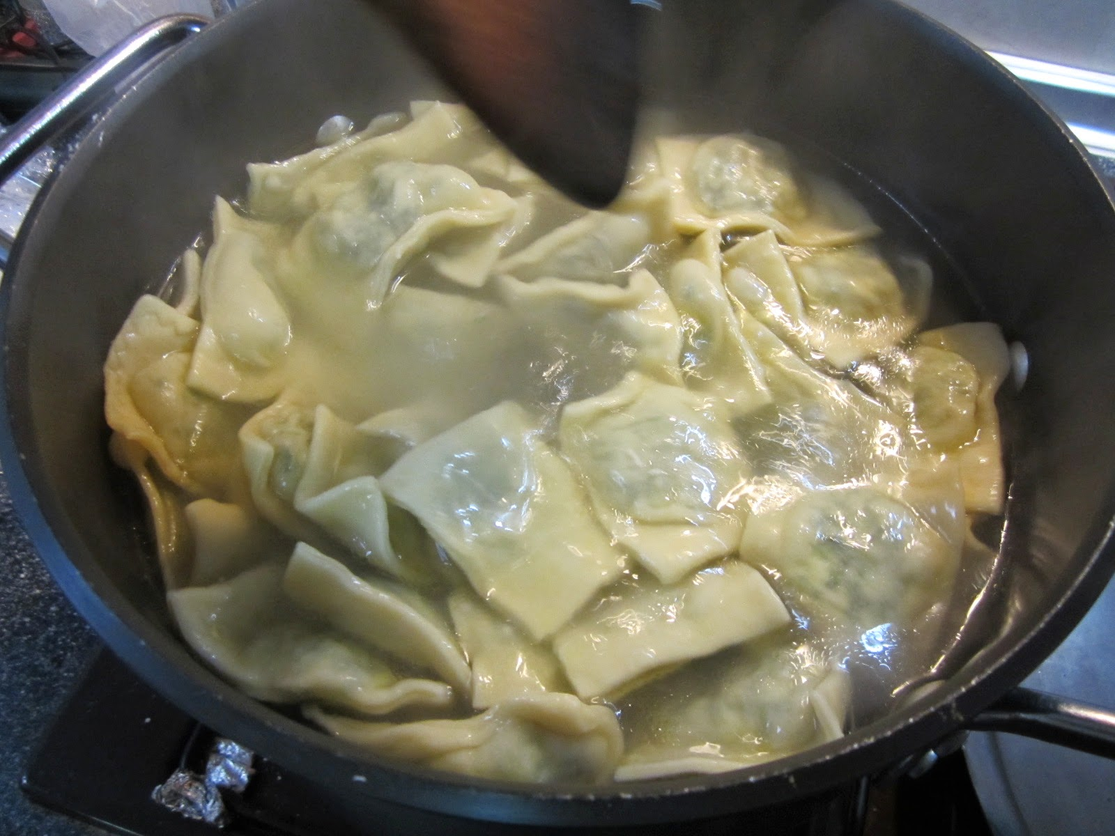 Food Lust People Love: Homemade spinach and cheese ravioli do take a little time but making your own pasta dough is right up there on the satisfaction scale with baking bread. You know what's in it. It's fresh and the taste is far superior to store-bought. Best of all, it's surprisingly easy.