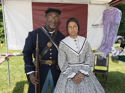 Fredrick Smith and with Jacque Smith posed at United States Color Soldier and his wife agt their booth. Photo by Joseph Fuqua II for WCPO Copyright 2018 Scripps Media, Inc. All rights reserved. This material may not be published, broadcast, rewritten, or redistributed.