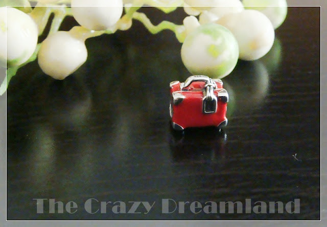 red travel suitcase charm