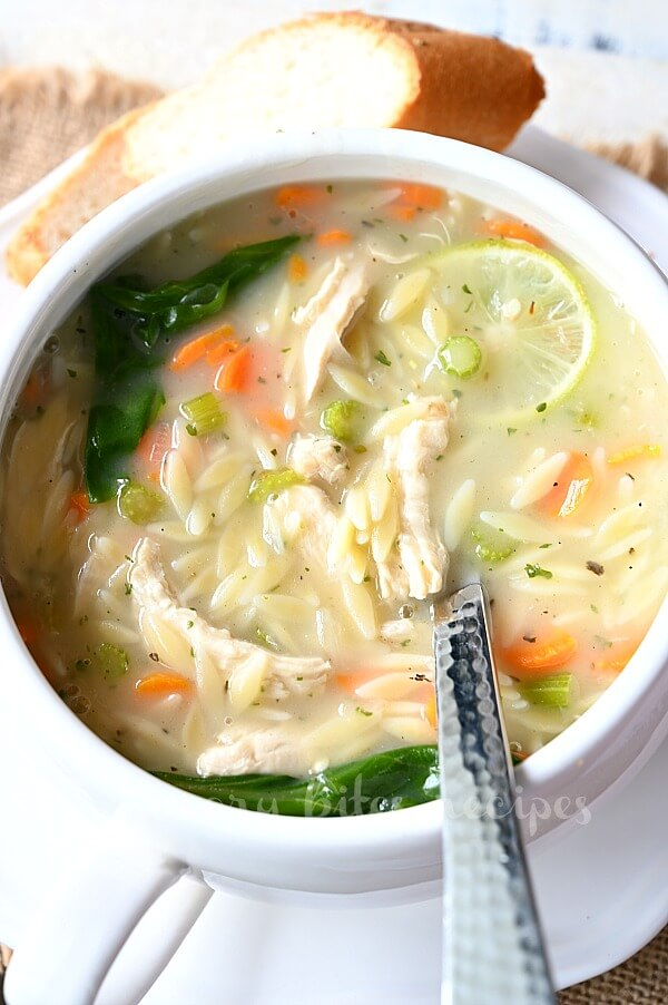 a white soup bowl with orzo chicken soup