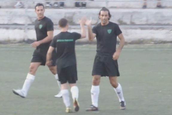 Robert Pirès celebrates after scoring a goal with his news 'teammates'