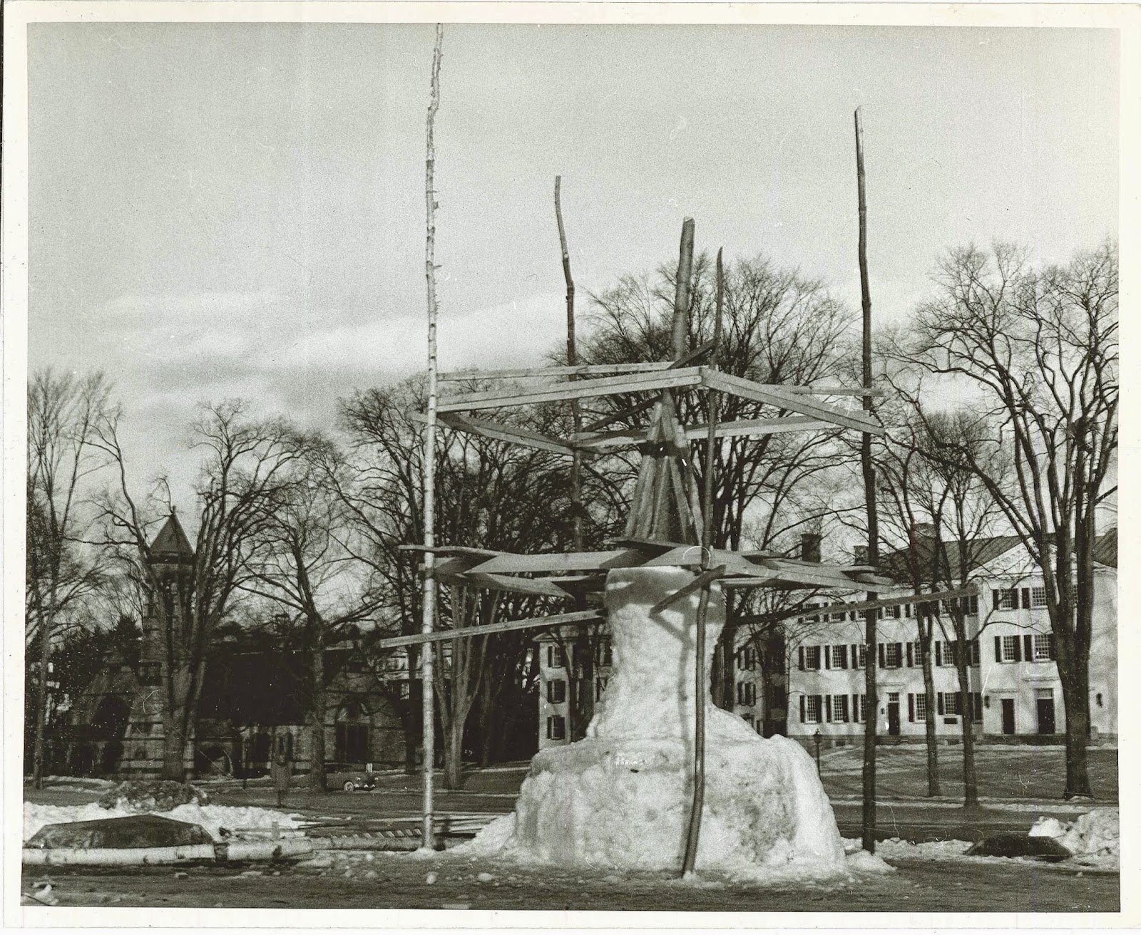 The unfinished sculpture surrounded by scaffolding.