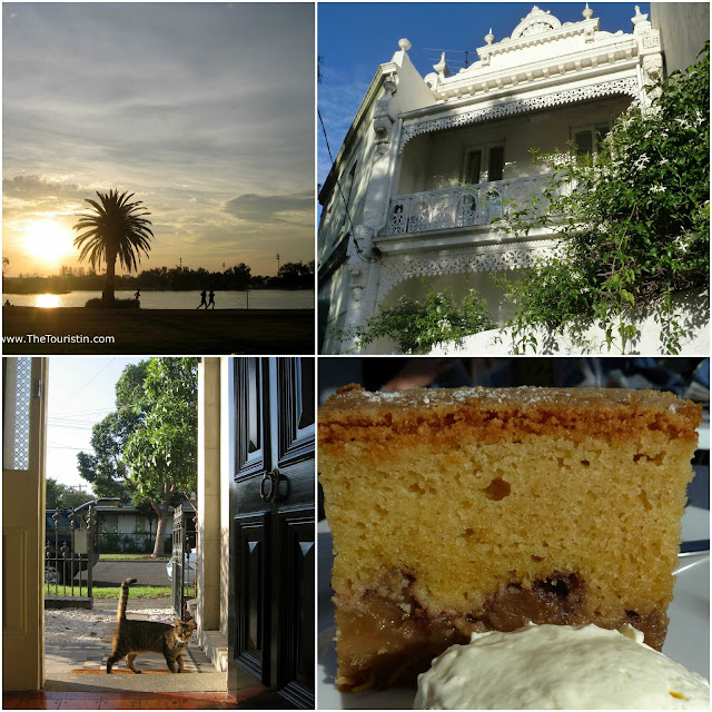 Sunset over a lake. The facade of a white Victorian house. A tiger cat looking through the front door of a Victorian house. Apple cake served with cream.