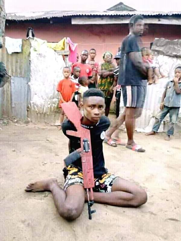 Teenage Armed Robber Caught And Tied With Rope By Vigilante In Rivers State (Photos)