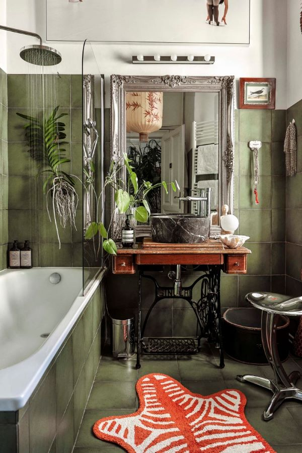 Nature inspired bathroom with green tile and plants