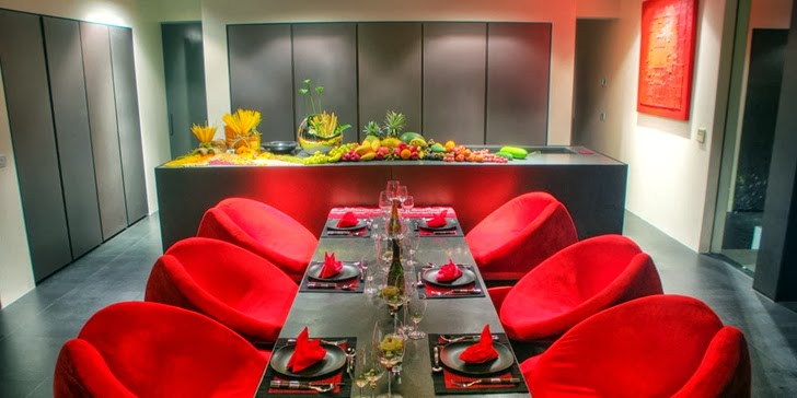 Red chairs at the dining table in an Amazing contemporary Villa Yin in Phuket