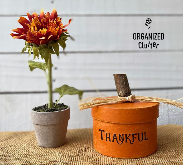 Photo of a Dollar Tree Box repurposed as a fall pumpkin