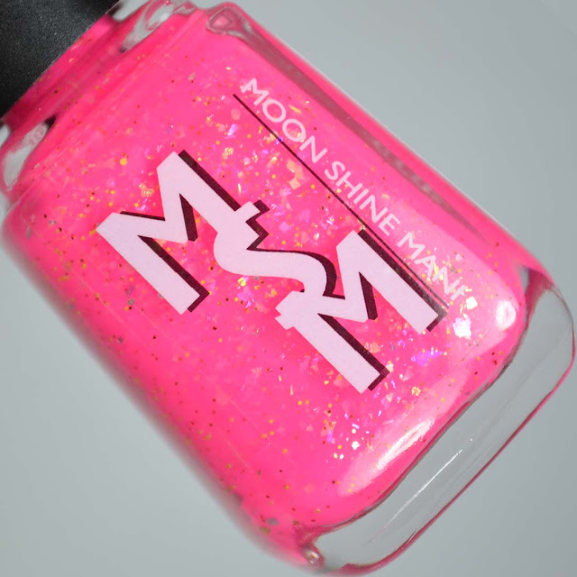 hot pink nail polish with flakies in a bottle