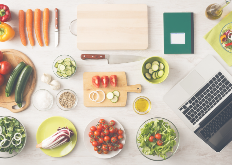A worktop with ingredients laid out to meal prep in a post about 13 simple tasks you can do to set you up for a productive week.