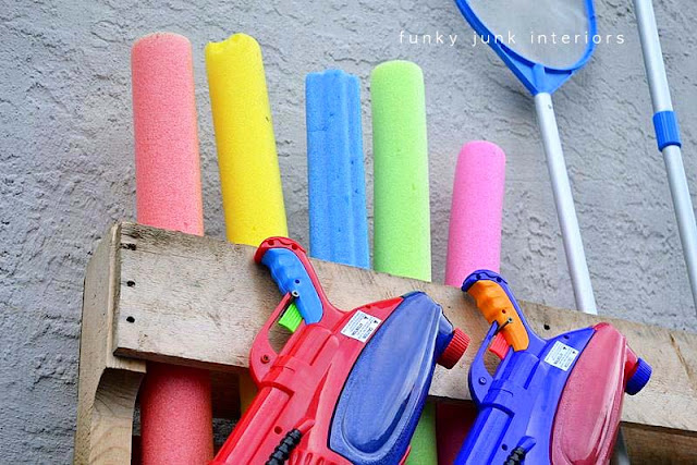Organize your pool gear with this pallet pool noodle organizer!