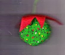Green printed fabric with solid red star cap makes fictional fruit Christmas ornament