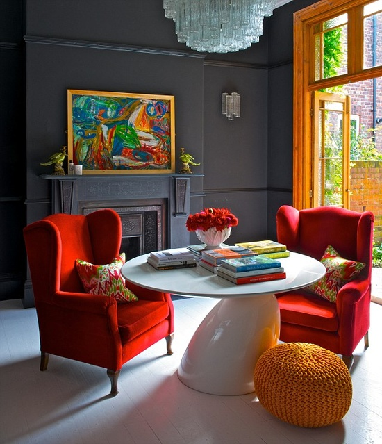 The Books Chairs And Yellow Vase Provide Red Blue Blocks Of Color