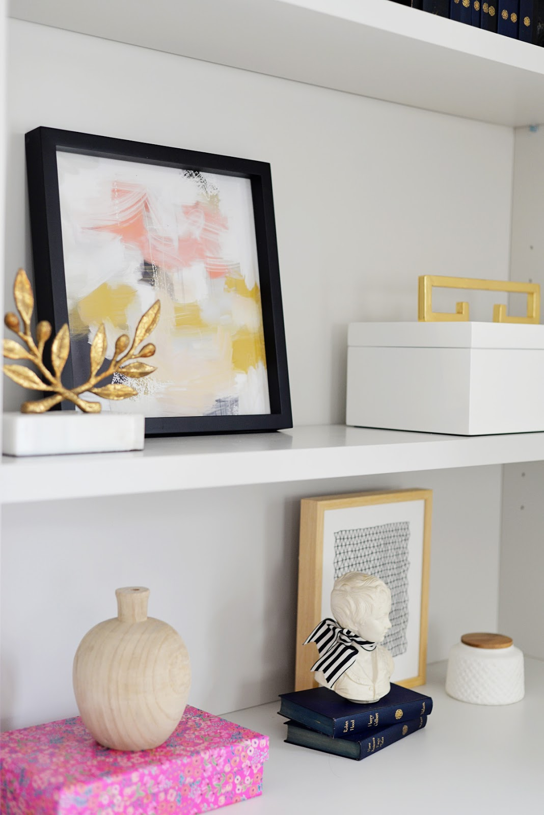 bookcase styling, pink and gold decor