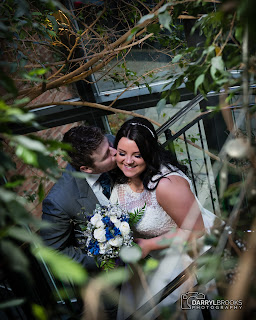 Bride and groom kissing on the stairs at their wedding at lazaat hotel cottingham