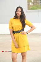 Actress Poojitha Stills in Yellow Short Dress at Darshakudu Movie Teaser Launch .COM 0035.JPG