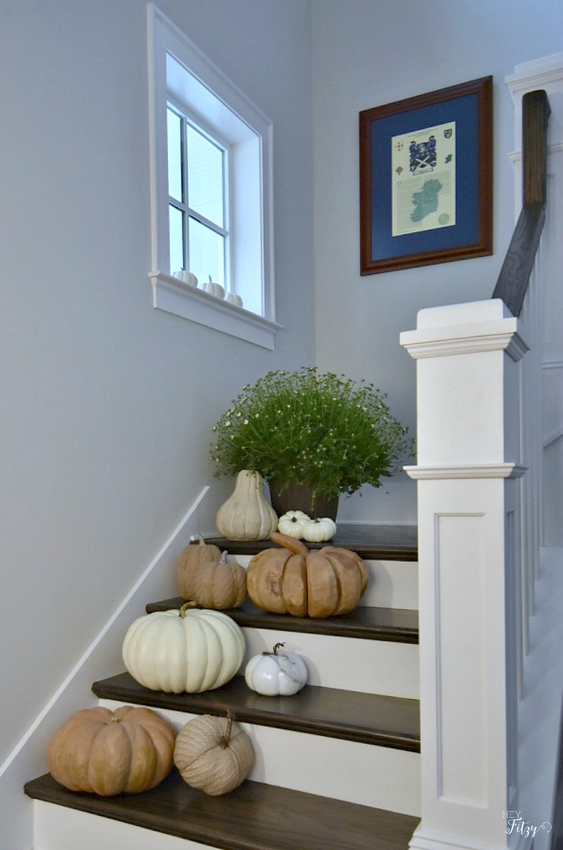 Beautiful southern style home filled with moldings, wooden floors, and wooden stairs. You'll love the fall decor.