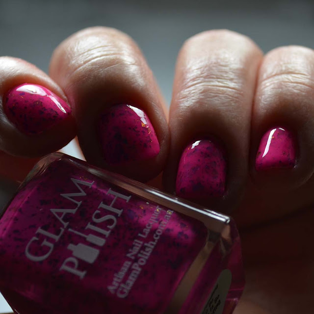 pink nail polish with color shifting flakies low light swatch
