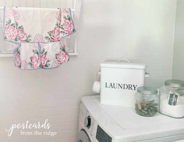 laundry room with floral apron and Duck Brand Smooth Top Easy Liner used on top of dryer