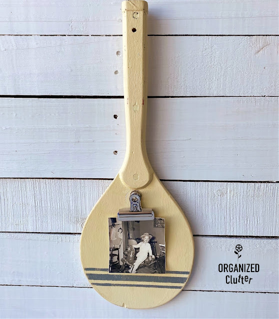 Photo of repurposed ping pong paddle photo display