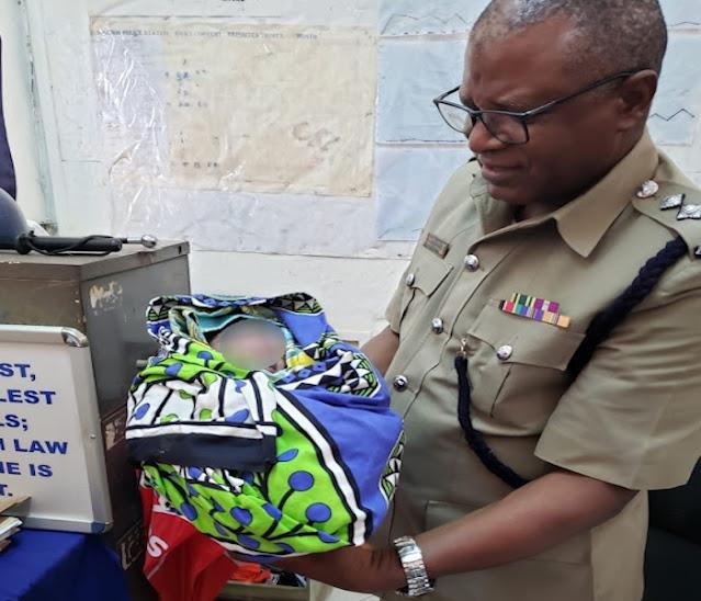 Malindi OCS Stephen Mwachia with the baby