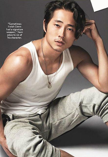 Steven Yeun posing in tank top