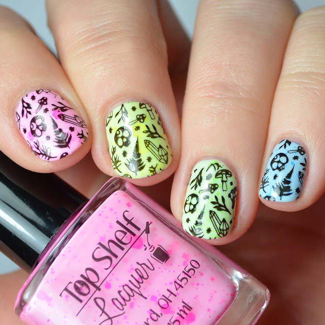 skull and mushroom stamping over rainbow nail polish