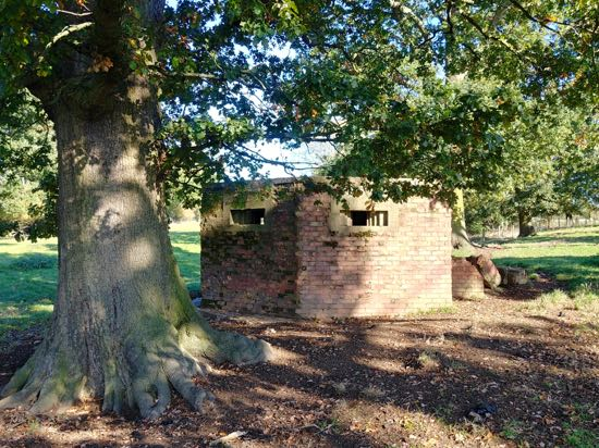 Photograph of A type 24 pillbox in the fields of Boltons Park Farm owned by the Royal Veterinary College Image by the North Mymms History Project released under Creative Commons BY-NC-SA 4.0