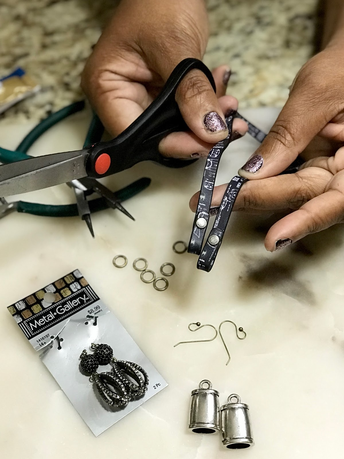 Image: Tangie Bell showing how she makes quick earrings for any occasion.