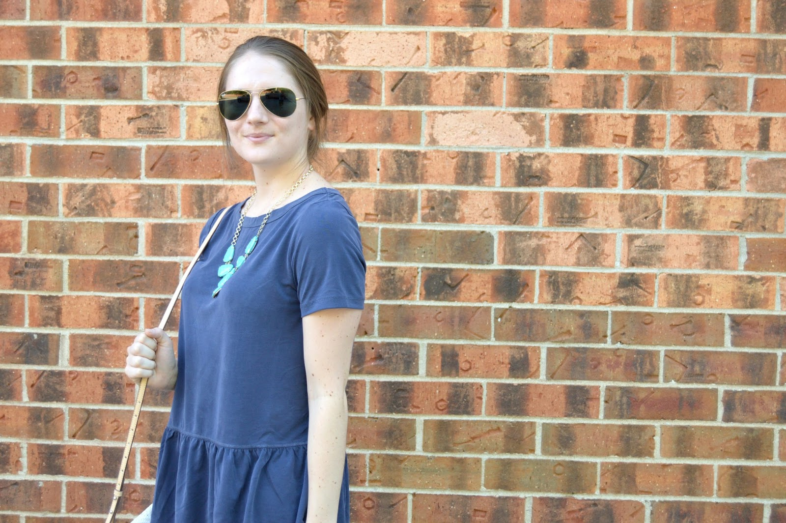 turquoise necklace with a navy shirt | what to wear this summer | summer outfit ideas | summer lookbook | summer street style | what to wear this summer | a memory of us | kansas city fashion blog