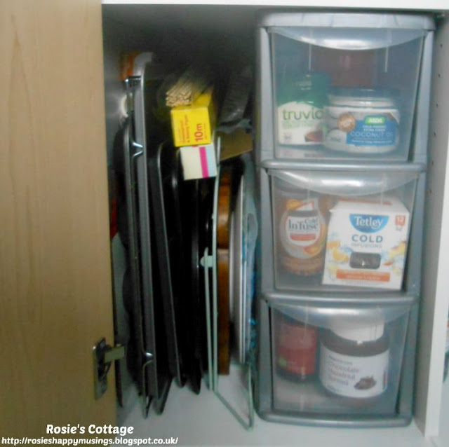 Kitchen Cabinet Re-Organisation: This shelf was possibly the easiest to organise because the it's home to items such as baking trays/cookie sheets and to a small set of plastic drawers, which I wanted to keep in place.