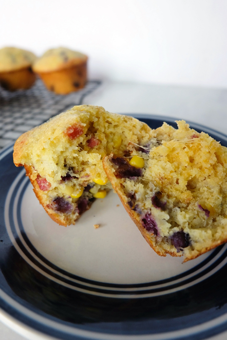inside of cornbread muffin with blueberry bacon and cheddar cheese