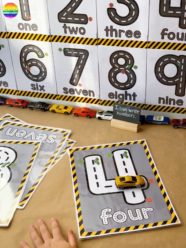 Road Themed Number Posters - Use these road transportation themed number posters to create an engaging display in your preschool or pre-k class! Or create hands-on, kinesthetic activities for young children to interact with as they learn to write the numerals 0-10! Practice numeral formation, number identification and sequencing. Just choose from the two different designs and print to play | you clever monkey