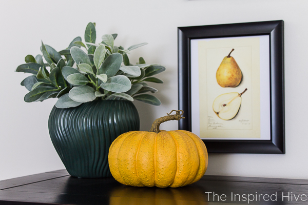 Spray painted vase, vintage pear art, and a yellow pumpkin
