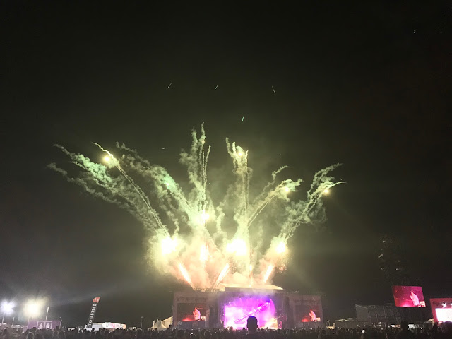 Festival stage surrounded by fireworks