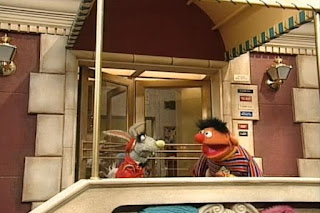 Benny Rabbit sleeps snoring in front of the Furry Arms Hotel. Ernie wakes up Benny Rabbit. Sesame Street 123 Count with Me