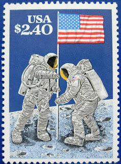 Apollo program: Apollo 11's crew successfully makes the first manned landing on the Moon in the Sea of Tranquility. Americans Neil Armstrong and Buzz Aldrin become the first humans to walk on the Moon six and a half hours later USA