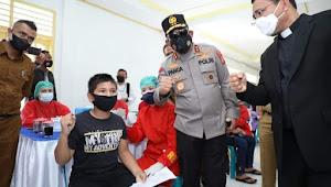 Kapolda Sumut Kunker ke HKBP Pearaja Tarutung, Tinjau Vaksinasi dan berikan Bansos