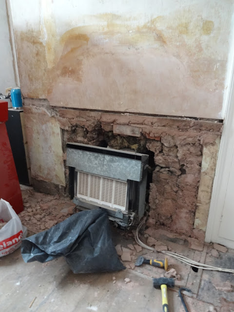 removing a 70s gas fire