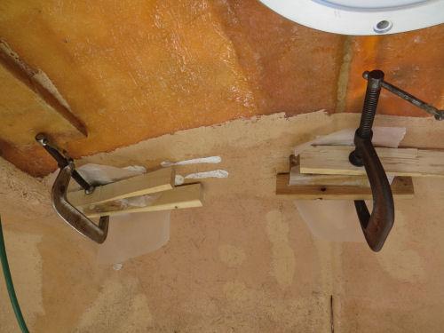 braces for an upper storage bin in a fiberglass trailer