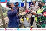 Operasi Ketupat 2021, Petugas Gabungan Polres Gowa Sampaikan Himbauan dan Bagikan Masker
