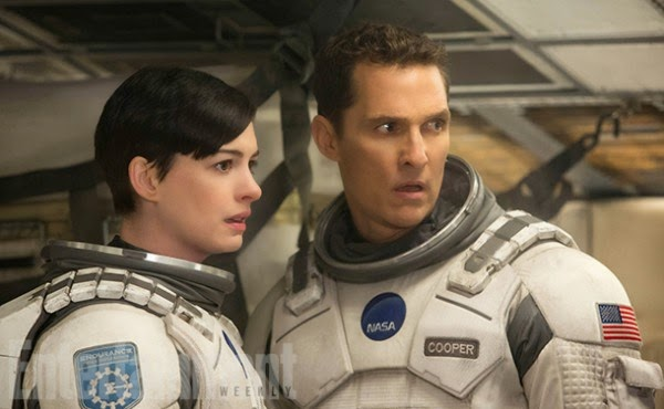 Anne Hathway as Amelia (left) with Cooper (played by Matthew McConaughey) in Interstellar, Directed by Christopher Nolan