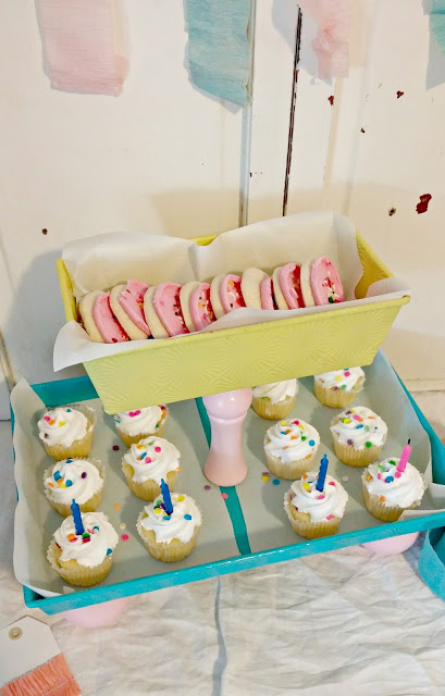 Use some old baking pans to create a fun tiered serving tray!
