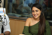 Pragya Jaiswal in a single Sleeves Off Shoulder Green Top Black Leggings promoting JJN Movie at Radio City 10.08.2017 045.JPG