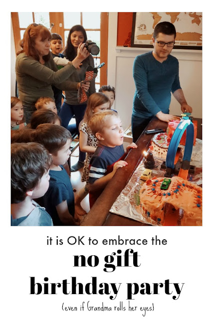 Kid blowing out birthday candles- It's OK to have a No Gift Birthday Party