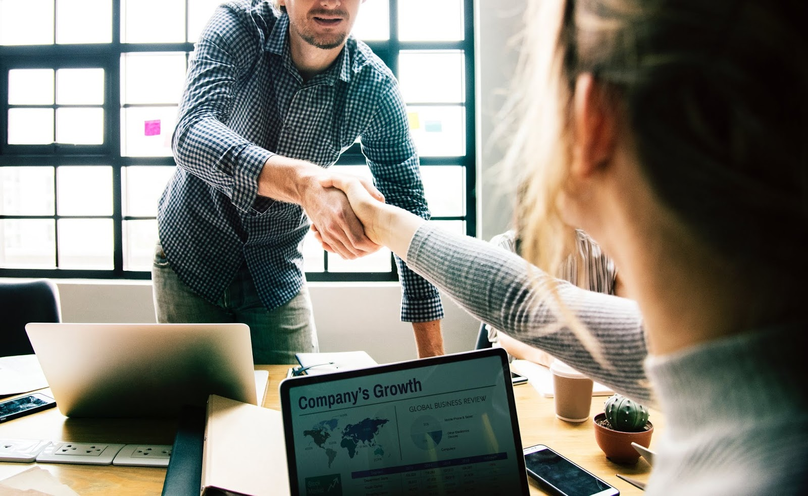 business man and woman shaking hands at an interview