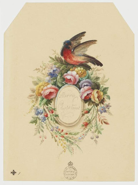 """Christmas Card design depicting a floral wreath with a red breasted black bird on top with the words """"Merry Christmas""""."""