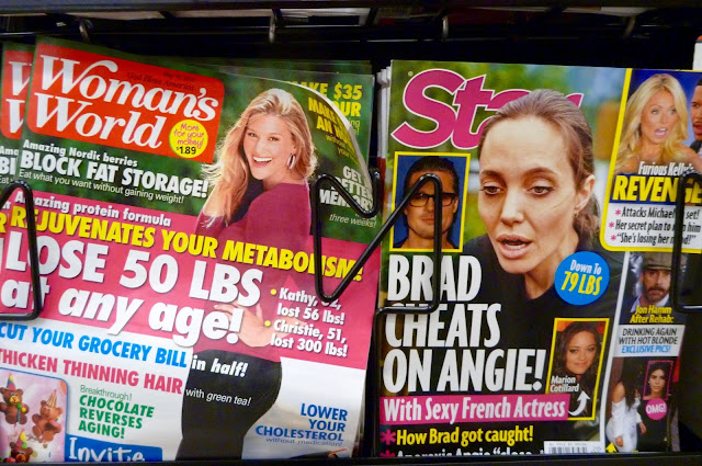Woman's World and Star Magazine in a supermarket display rack