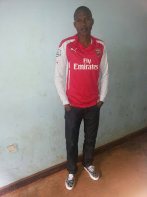 Gideon Paul with Arsenal Jersey